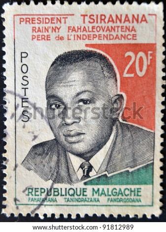 MADAGASCAR - CIRCA 1960: A stamp printed in Madagascar shows tribute to President Tsiranana - Independence Day, circa 1960