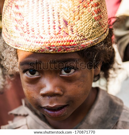 MADAGASCAR - JUNE 30, 2011: Portrait of an unidentified little girl in a hat in Madagascar, June 30, 2011. Children of Madagascar suffer of poverty due to the unstable situation.