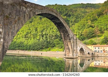 Maddalena Bridge at Bagni di Lucca, Tuscany, Italy. Also known as the Devil's Bridge - stock photo