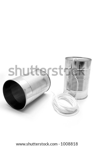 made of tin cans and string - stock photo