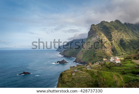 Madeira island north coast landscape. Steep rocks and mountains on the Atlantic ocean shore. Portugal.