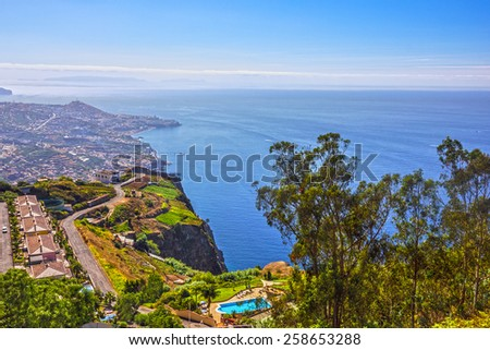 Madeira island, Portugal. Landscape on the Southern Coast, Cabo Girao, Atlantic Ocean and Funchal. Cabo Girao is famous for its sea cliff; the second highest in the world at 589 m. - stock photo