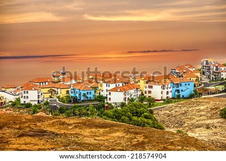 Madeira island, Portugal. Town houses of Porto Cruz and Ponte de Sao Lourenco - stock photo