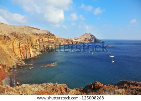 Madeira. Picturesque white yachts in the rocky gulf in the east of the island