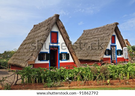 Madeira, the city of Santana. Pastoral landscape. Two charming rural houses with triangular thatched roof - stock photo