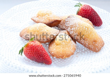 Madeleine small traditional French desserts with strawberries