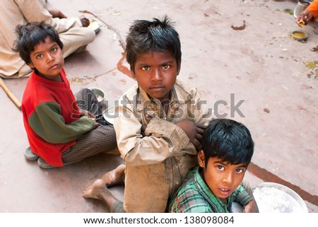 MADHYA PRADESH, INDIA - DEC 30: Unidentified poor children play on the street on December 30, 2012 in Chitrakoot India. Madhya Pradesh is the 2nd largest Indian state, with 105,592 primary schools - stock photo