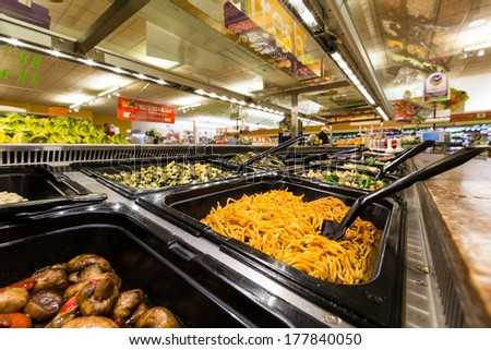 MADISON, NJ, UNITED STATES - FEBRUARY 13, 2014: Salad bar in an American supermarket. Health-conscious consumers are generally willing to pay more for food that they believe is healthy for them. - stock photo