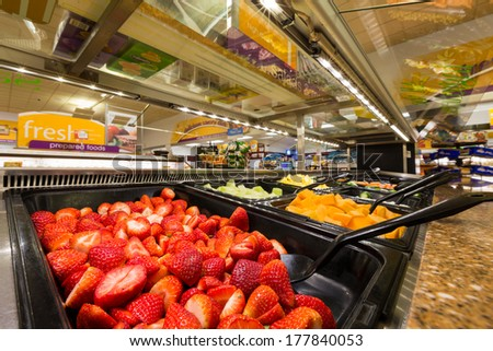 MADISON, NJ, UNITED STATES - FEBRUARY 13, 2014: Salad bar in an American supermarket. Health-conscious consumers are generally willing to pay more for food that they believe is healthy for them.
