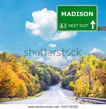 MADISON road sign against clear blue sky - stock photo