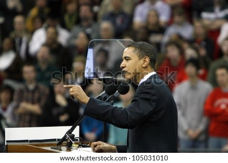 MADISON, WI-FEB. 12:Barack Obama gives a speech to a crowd assembled at the Kohl Center in Madison, Wisconsin on February 12, 2008 just before the Wisconsin primary vote. - stock photo