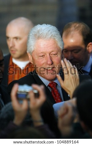MADISON, WI-FEB. 14:President Bill Clinton greets a crowd of admirers following a speech in support of Hillary Clinton's Democratic presidential primary nomination on February 14, 2008 in Madison, WI. - stock photo