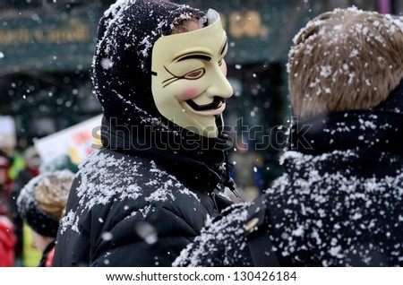 MADISON, WI - FEB 26:Protester wearing Anonymous mask in Wisconsin during a rally against Governor Scott Walker's budget bill on Feb 26, 2011. Walker  still faces a new election next year - stock photo