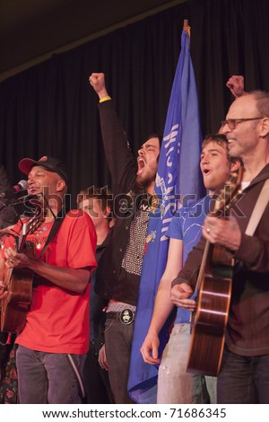 MADISON, WI - FEB. 21: Tom Morello (The Nightwatchman) and Wayne Kramer (MC5) perform at the Monona Terrace in Madison, WI on February 21, 2011 to rally for worker's rights in an anti-Walker protest. - stock photo