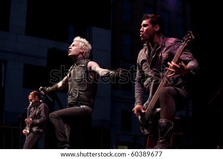 MADISON, WI - SEP. 5: Powerman 5000 perform live at the WJJO Rock stage at Taste of Madison in Madison, Wisconsin on September 5, 2010. - stock photo