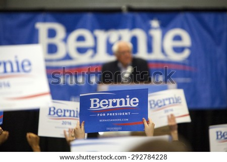 MADISON, WI/USA - July 1, 2015: A group of supporters hold up a Bernie Sanders for President sign during a rally of over 10,000 people for Bernie Sanders in Madison, Wisconsin. - stock photo