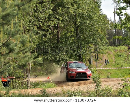 MADONA, LATVIA-JUNE 9: Roland Murakas and Kalle Adler drives Mitsubishi Lancer Evo during a motoring event Rally Madona 2012 in Madona, Latvia on June 09, 2012.