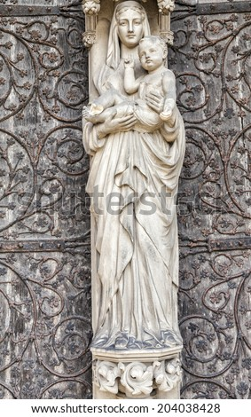 Madonna and Child  statue on front of Lichfield Cathedral.Staffordshire, England, Britain. - stock photo