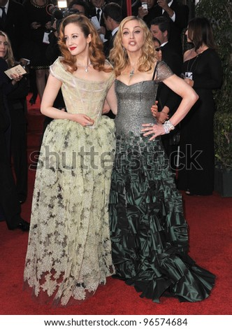 Madonna & Andrea Riseborough at the 69th Golden Globe Awards at the Beverly Hilton Hotel. January 15, 2012  Beverly Hills, CA Picture: Paul Smith / Featureflash - stock photo
