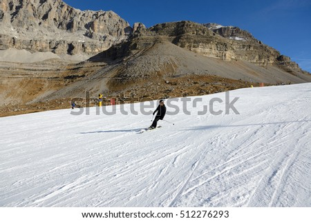 MADONNA DI CAMPIGLIO, ITALY - DECEMBER 18: The ski slope and skier on December 18, 2015 in Madonna di Campiglio, Italy. More then 46 mln tourists is expected to visit Italy in year 2015.