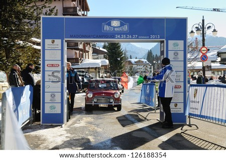 MADONNA DI CAMPIGLIO (TN) ITALY - JANUARY 26: Antonino Margiotta, winner of 2013 Winter Marathon, starts the race on a 1965 Morris Mini Cooper S4, on January 26, 2013 in Madonna di Campiglio (TN) - stock photo