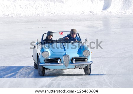 MADONNA DI CAMPIGLIO (TN) ITALY - JANUARY 26: Cavagna - Bossini drive their 1960 Alfa Romeo Giulietta spider, during the 2013 Winter Marathon on January 26, 2013 in Madonna di Campiglio (TN) - stock photo