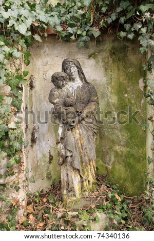 Madonna with her Child on the old Prague Cemetery, Czech republic - stock photo