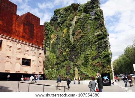 MADRID-APRIL 27.  Caixa Forum and facade of plants by botanist Patrick Blanc on April 27,2009 Madrid (Spain) - stock photo