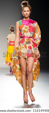 MADRID - AUGUST 31: A model walks on the Victorio & Lucchino catwalk during the Cibeles Madrid Fashion Week runway on August 31, 2012 in Madrid.