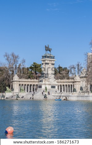MADRID, ES - JANUARY 24, 2013: People enjoying the Great Pond (Estanque del Retiro), which served as the setting for mock naval battles and other aquatic displays on Buen Retiro Park.