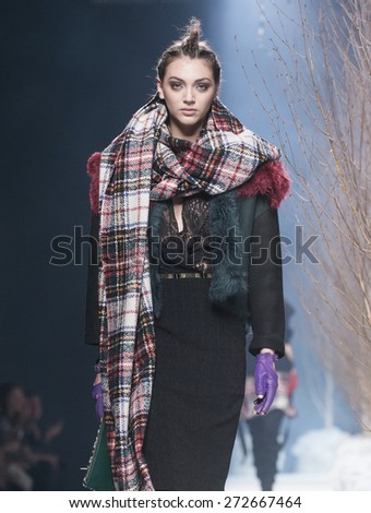 MADRID - FEBRUARY 10: a model walks on the Alvarno catwalk during the Mercedes-Benz Fashion Week Madrid Fall/Winter 2015 runway on February 10, 2015 in Madrid.  - stock photo