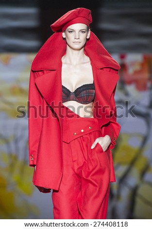MADRID - FEBRUARY 07: a model walks on the Andres Sarda catwalk during the Mercedes-Benz Fashion Week Madrid Fall/Winter 2015 runway on February 07, 2015 in Madrid.  - stock photo