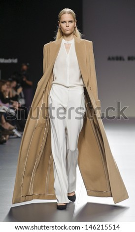 MADRID - FEBRUARY 19: A model walks on the Angel Schlesser catwalk during the Cibeles Madrid Fashion Week runway on February 19, 2013 in Madrid.  - stock photo