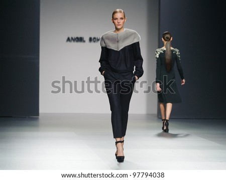 MADRID  FEBRUARY 02: A model walks on the Angel Schlesser catwalk during the Mercedes-Benz Fashion Week Madrid runway on February 02, 2012 in Madrid, Spain. - stock photo