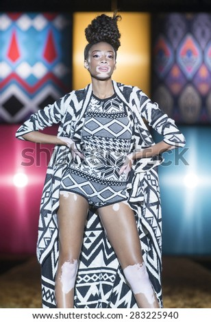 MADRID - FEBRUARY 06: a model walks on the Desigual catwalk during the Mercedes-Benz Fashion Week Madrid Fall/Winter 2015 runway on February 06, 2015 in Madrid.  - stock photo