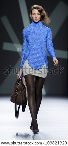 MADRID - FEBRUARY 01: A model walks on the Devota & Lomba catwalk during the Mercedes-Benz Fashion Week Madrid runway on February 01, 2012 in Madrid, Spain.