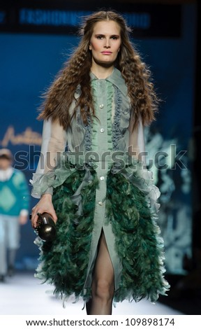 MADRID - FEBRUARY 01: A model walks on the Francis Montesinos catwalk during the Mercedes-Benz Fashion Week Madrid runway on February 01, 2012 in Madrid, Spain. - stock photo