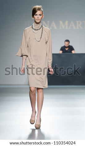 MADRID - FEBRUARY 03: A model walks on the Juana Martin catwalk during the Mercedes-Benz Fashion Week Madrid runway on February 03, 2012 in Madrid, Spain.