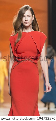 MADRID - FEBRUARY 17: a model walks on the Juanjo Oliva catwalk during the Mercedes-Benz Fashion Week Madrid Fall/Winter 2014-2015 runway on February 17, 2014 in Madrid.  - stock photo