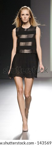 MADRID - FEBRUARY 18: A model walks on the Teresa Helbig catwalk during the Cibeles Madrid Fashion Week runway on February 18, 2013 in Madrid.