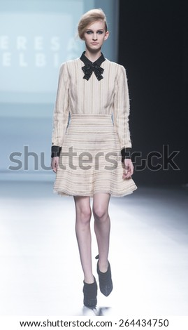 MADRID - FEBRUARY 07: a model walks on the Teresa Helbig catwalk during the Mercedes-Benz Fashion Week Madrid Fall/Winter 2015 runway on February 07, 2015 in Madrid.