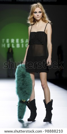 MADRID  FEBRUARY 03: A model walks on the Teresa Helbig catwalk during the Mercedes-Benz Fashion Week Madrid runway on February 03, 2012 in Madrid, Spain. - stock photo
