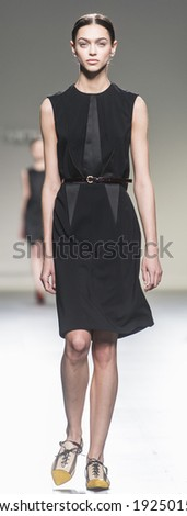 MADRID - FEBRUARY 16: a model walks on the Victorio & Lucchino catwalk during the Mercedes-Benz Fashion Week Madrid Fall/Winter 2014-2015 runway on February 16, 2014 in Madrid.