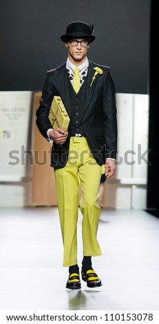 MADRID - FEBRUARY 03: French model Clement Chabernaud walks on on the Ana Locking catwalk during the Mercedes-Benz Fashion Week Madrid runway on February 03, 2012 in Madrid, Spain.