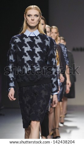 MADRID - FEBRUARY 19: Models walking on the Angel Schlesser catwalk during the Cibeles Madrid Fashion Week runway on February 19, 2013 in Madrid.