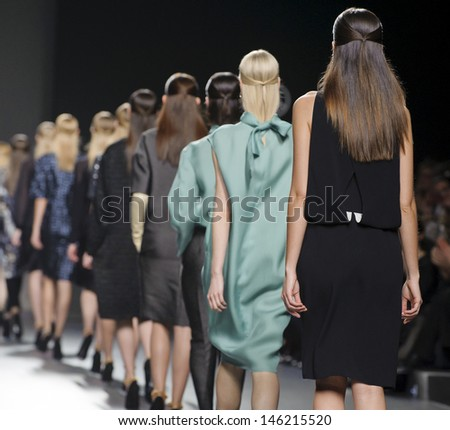 MADRID - FEBRUARY 19: Models walking on the Angel Schlesser catwalk during the Cibeles Madrid Fashion Week runway on February 19, 2013 in Madrid.  - stock photo