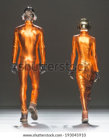 MADRID - FEBRUARY 17: models walking on the Carlos Diez catwalk during the Mercedes-Benz Fashion Week Madrid Fall/Winter 2014-2015 runway on February 17, 2014 in Madrid.  - stock photo
