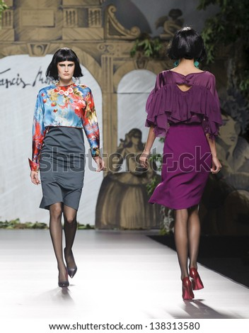 MADRID - FEBRUARY 18: Models walking on the Francis Montesinos catwalk during the Cibeles Madrid Fashion Week runway on February 18, 2013 in Madrid. - stock photo