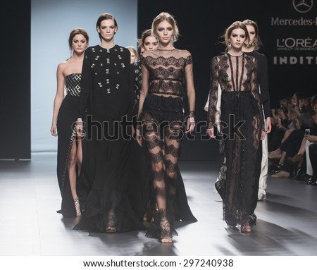 MADRID - FEBRUARY 08: models walking on the Juana Martin catwalk during the Mercedes-Benz Fashion Week Madrid Fall/Winter 2015 runway on February 08, 2015 in Madrid.  - stock photo
