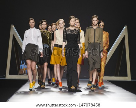 MADRID - FEBRUARY 21: Models walking on the Moises Nieto catwalk during the Cibeles Madrid Fashion Week runway on February 21, 2013 in Madrid.  - stock photo